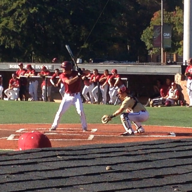 How to get hit by pitch. Turn body , get face out if way and drop bat down behind you. Alec Bankhead getting hit today in Elon Workd Series game.